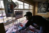 MJM049  Brother Jeff Fard (cq) arranges Barack Obama shirts reading Mr. President at Brother...