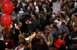(PG1060) Unemployed workers talk with companies at a job fair in Longmont, Colo., on Wednesday,...