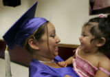 Yuri Frias, 18, cq, a single mother, of Denver, gets a great big smile from her 1-year-old...