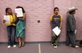 (left to right) Janey Martinez (cq) ,11, Patricia Lopez(cq) ,12, Omar Talavera(cq) ,11, and Mario...