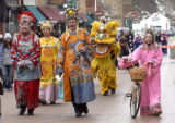 Steve McEnroe/Journal staff: JoAnn and Vince Coyle, in colorful and traditional Chinese attire,...