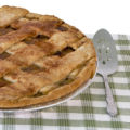 a delicious latticed apple pie is just waiting to be dug into. A pretty setting with ivy wallpaper...