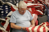 Warren Teasdale (cq), 70, cuts-up a flag to prepare it to be retired at the West Metro Fire...