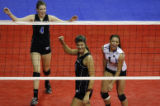DM9064  Grandview's Erica Denney pumps her fist in celebration as her teammates McCall Paynter,...