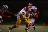 #33 Blair Zimmerman (cq) of Heritage reaches to tackle #10 Laterell Burrows (cq) of Sierra during...