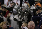 JPM1353 Denver Broncos fans react to Oakland Raiders fan Nick LaPenna, of Commerce City, during...
