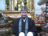 Carol Gansho  ODowd at Buddhist altar Sunday from torkelson