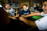 Berenice Carrillo, 10, (cq) Eloy Franco, 10, (cq) and Victor Prendis, 11, (cq) (L-R) joke around...
