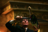 (PG2446) Master saber Bernard Ganter opens a bottle of champagne during the Brown Palace Hotel's...