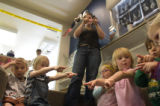 (004) Season to Share: Children share a song-play at the Boulder Day Nursery, a non-profit day...