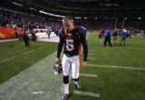 (751) Matt Prater walks off the field after missing 2 field goal as the Broncoa lost 31-10 against...