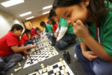 MJM024  Shannon Montoya (cq), 7, right, concentrates on a move as she plays chess along with other...