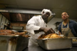 (PG2806) Chef Marriese Jones checks a turkey as Jeff Fischer watches on Tuesday, November 25, 2008...