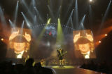 (0502) Angus Young of AC/DC makes devil horns as he performs at the Pepsi Center in Denver, Colo.,...
