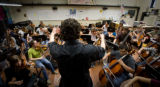 (Denver, Colorado, Nov. 3, 2008) Conductor Ilyich Rivas (15) rehearses Beethoven's 8th Symphony...