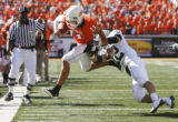 Zac Robinson gets knocked out of bounds by Jake La Mar at the Oklahoma State University (OSU)...
