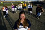 Coach Wendy Davies of Ralston Valley (cq) stands in front with Ashlie Ortega, 17, of Erie (cq)...