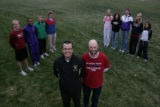 The All-Colorado boys and girls cross country team pose for a portrait on Monday, November 10,...