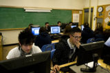 Robert Grajeda, 17, (cq) sits next to Sergio Jaime, 16, (cq) during a computer class at Lincoln...