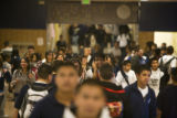 Students walk the halls at the end of their school day at Lincoln High School, 2285 South Federal...