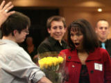 Highlands Ranch High School teacher, Susan Elliott, right, reacts to getting flowers from one of...