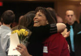 Highlands Ranch High School teacher, Susan Elliott, right, gets a hug from one of her former...