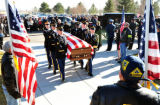 The casket of Colorado Army National Guard Sgt. Jon Stiles is moved to Shelter B at Fort...