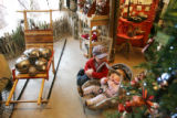 Eat!Drink!Shop! in Golden, Colorado.  Sam McArthur, 3, watches his nine-month old sister, Ally,...