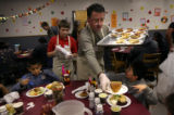 (PG3723) Ken Brake serves pie during the Denver Rescue Mission's big Thanksgiving banquet on...