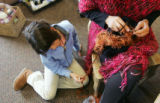 (0118) Addie Glickstein watches as her mother Robin Glickstein knits a hat at i Love Knitting in...