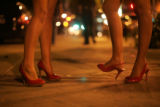 Raquel Gutierrez (cq), 18, and Nicole Herrera (cq), 18, stand outside Beta nightclub while waiting...