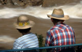 Maizie and John Brandt, Durango, cq, sit along the Animas River in Whitewater Park in Durango on...