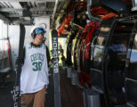 Jack Beezer, (cq), 14, gets off the gondola after skiing, Friday morning, June 13, 2008, Aspen...