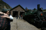 Karen Adler, cq, hugs Pete Gores, cq, General Manager of the Georgetown Loop Railroad to...