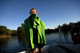 Mike Whitney (cq) dries off inside the boat. Waterskiing in Colorado can be cold, sometime Whitney...