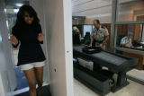Ashley Blythe, 21, (cq) walks through the Douglas County Justice's new security system.  The L3...