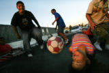 MJM455  Adam Ramirez (cq), 12, left, goes to pick up a soccer ball as Mirewa Quinonez, 5, right,...