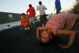 MJM480  Mirewa Quinonez, 5, right, leans backwards on a trampoline near her families mobile home...