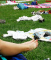 Lauren Bowler, 17, of Arvada, lies out in the sun amidst a scattering of towels and clothing June...