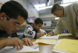DM0045  Joseph Watson, 15, left, works on a geometry problem as Mario Composano, 14, gets help...