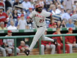 NAT106 - Los Angeles Angels' Vladimir Guerrero runs toward home to score as Casey Kotchman reached...