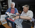 Pat and Denny Daily in their dining room with the cases and boxes of medical records ,...