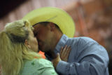 DM1241  T.J. Fox, a professional team roper, pulls his fiance Amy Marick  close and kisses her...