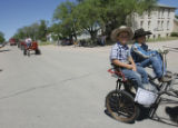 DM1943  Wyatt Schnug, 7, left, and his brother Bryce, 9, ride a small horse drawn cart in the...