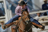 DM2330  Barrel racer Kalena Parker charges toward the finish after coming around the third barrel...