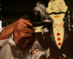 "Chef Jacques Torres puts the finishing touches on a chocolate ""butler"" centerpiece..."
