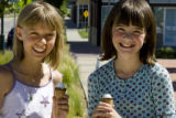 Miriam Vonnahme, left, of Stapleton and her friend Casey Schilling of Denver enjoy ice cream while...