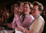 Audience members applaud chef Ming Tsai's cooking demonstration a the Food and Wine Classic in...