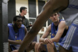 (156)  St. Joseph's guard Patrick Calathes, right, and D.J. White of Indiana, left, look on as...