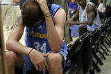 (157)  St. Joseph's guard Patrick Calathes, front, takes a brief moment to relax during his...